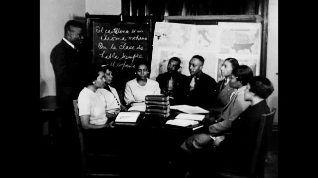 african american men and women in night class session studying spanish and various subjects / african american clerical workers sorting land records... - 1937 stock videos and b-roll footage