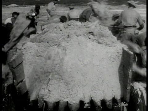 african american men digging w/ shovels ws land surveyor construction site crane ws black men shoveling dirt onto truck ws black farmer on cotton... - anno 1933 video stock e b–roll