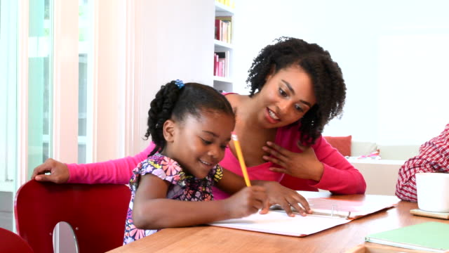african american mother helping daughter do homework - homework stock videos & royalty-free footage