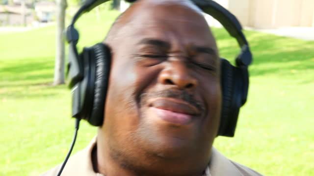 African American Senior Listening to Music