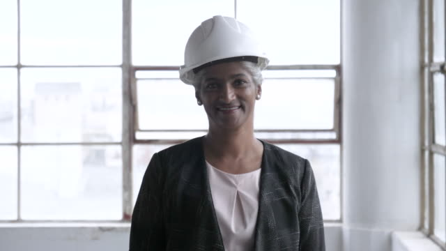 african american senior woman with hard , close up - hard hat stock videos & royalty-free footage