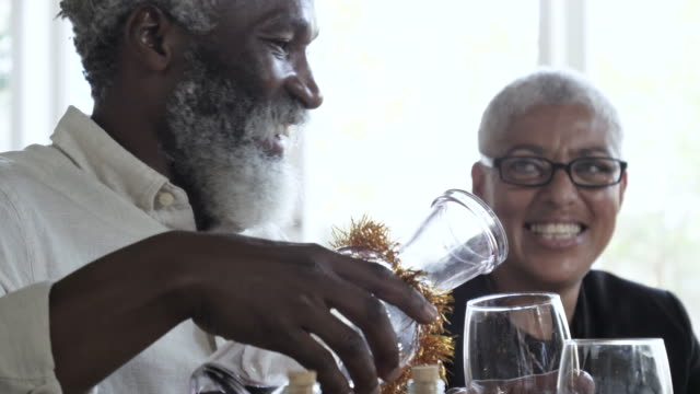 african american seniors drink wine, close up - service stock videos & royalty-free footage