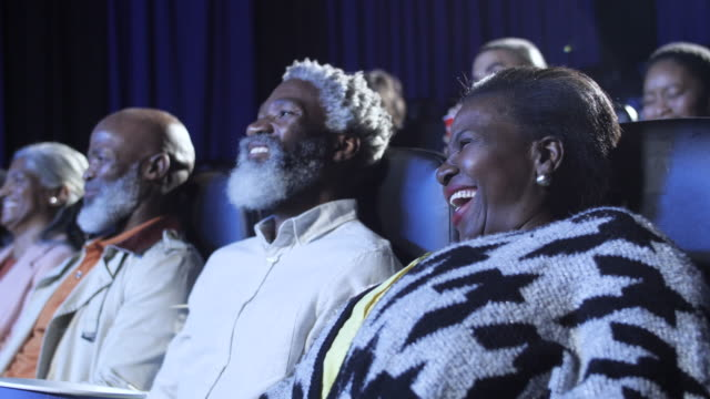african american seniors laugh in movie theatre, close up - black jacket stock videos & royalty-free footage