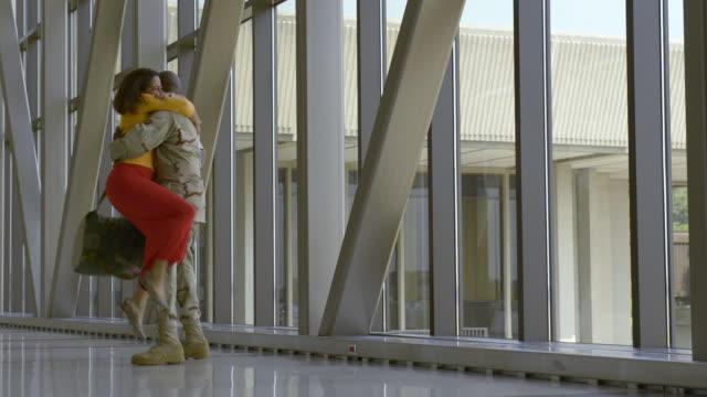 African American soldier greeting girlfriend in airport