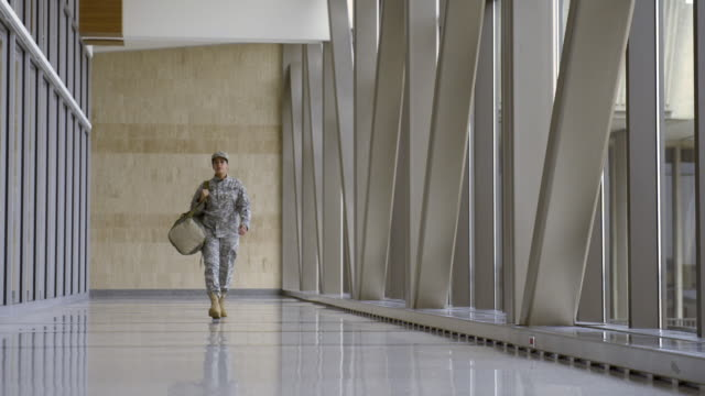 African American soldier walking in airport