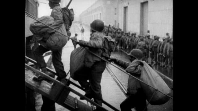 / African American soldiers collecting their kit bags / soldiers walking onto ship African American soldiers deployed in WWII on January 01 1944
