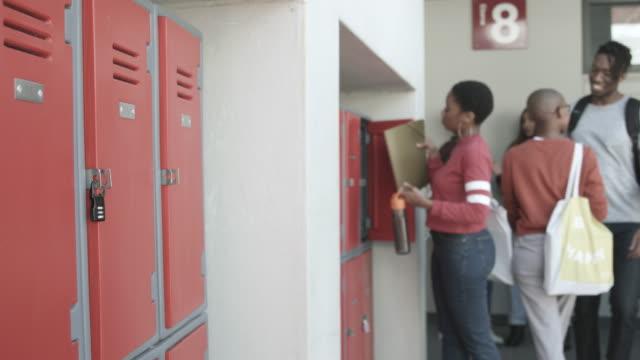 african american students at locker, close up - locker stock videos & royalty-free footage
