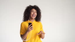 African american woman dancing while listening music on headphones