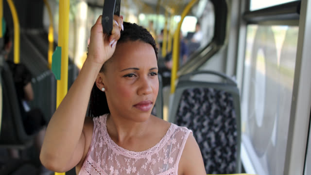 african american woman in a bus - braided hair stock videos and b-roll footage