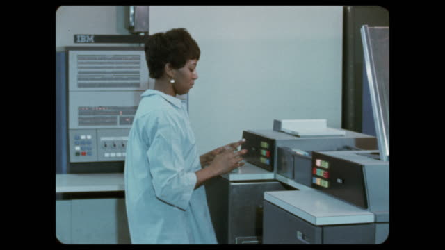 african american woman operating ibm system/360 computer - african ethnicity stock videos & royalty-free footage