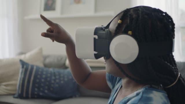 african american woman playing game with vr headset points and draws in the air. - african american ethnicity stock videos & royalty-free footage