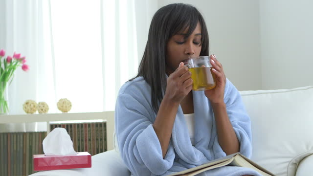 african american woman sick with flu drinking tea - tea hot drink stock videos & royalty-free footage