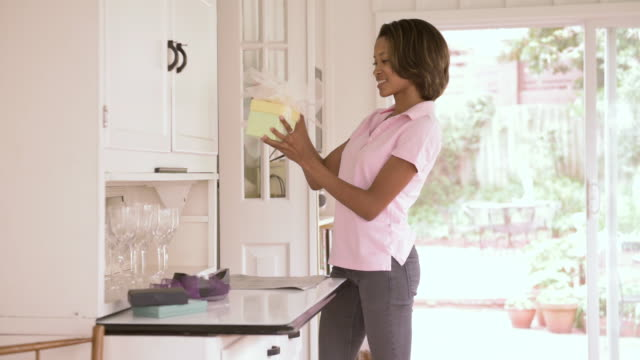 african american woman wrapping gift - wrapping stock videos & royalty-free footage