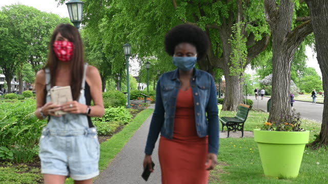 african american women wearing homemade mask in a public park - public park stock videos & royalty-free footage