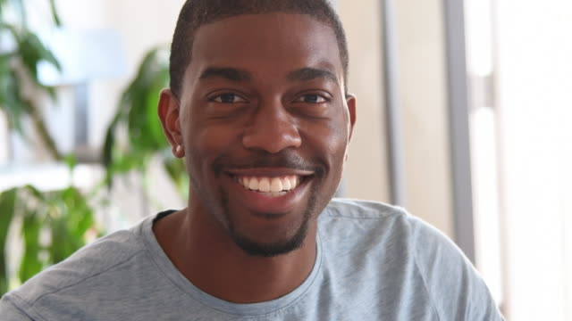 African American young man portrait smiling looking to camera