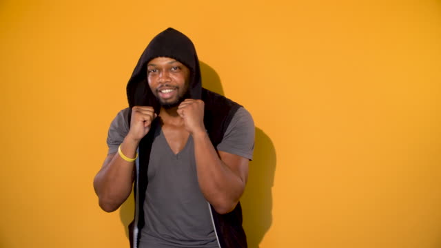 african american young man shadow boxing - yellow background stock videos & royalty-free footage