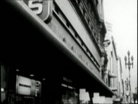 african americans and student demonstrators form a picket line in front of woolworth's to oppose the segregation of lunch counters - streikposten stock-videos und b-roll-filmmaterial