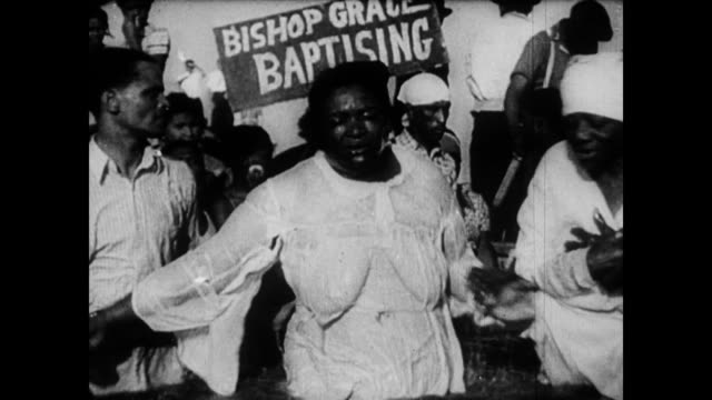 / african americans attending a christian baptism ceremony for adults / everyone dressed in white / people are dunked in the river, flinging their... - revival stock videos & royalty-free footage