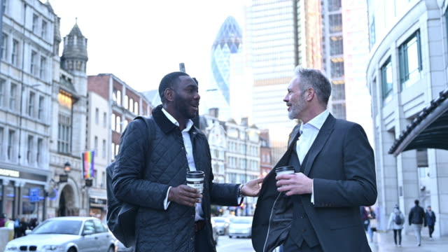 african and caucasian businessmen talking outdoors in london - geographical locations stock videos & royalty-free footage