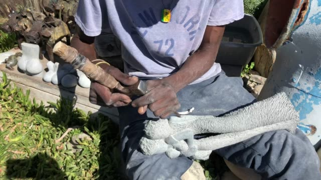 African Artist Chisels Figures out of Stone