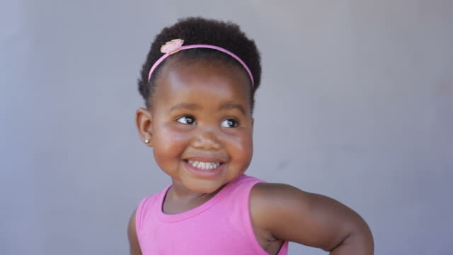 african baby girl laughing, dancing and just having fun. - baby girls stock videos & royalty-free footage