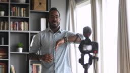 African blogger teacher record tutorial dance class on digital camera
