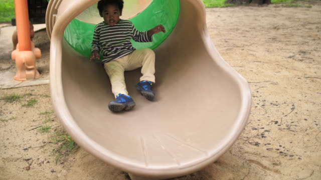 african boy playing slider at the play ground - 2 3 years stock videos & royalty-free footage