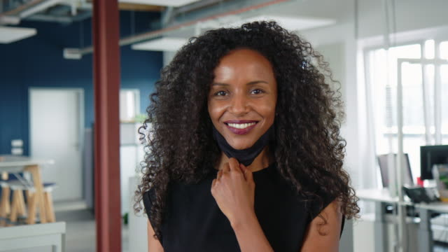 african businesswoman back to work after pandemic - absence stock videos & royalty-free footage
