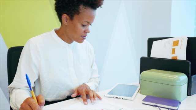 african businesswoman working in the office. - desk stock videos & royalty-free footage