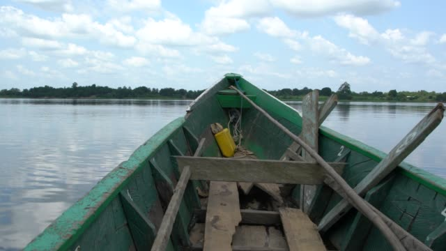 african canoe crossing river volta in ghana - ghana stock videos & royalty-free footage
