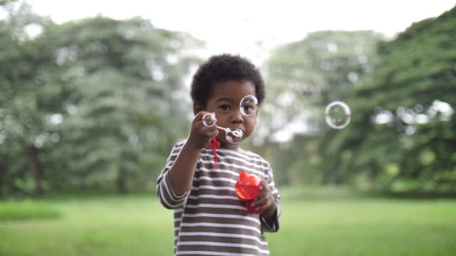 african children blowing bubbles in slow motion - bubble wand stock videos & royalty-free footage