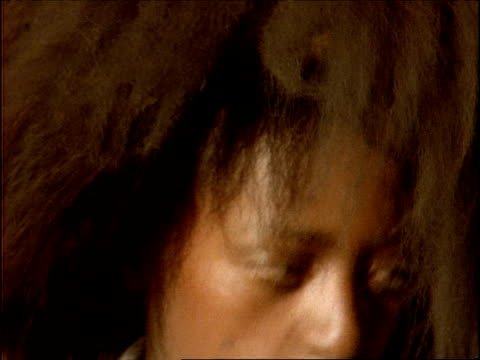 stockvideo's en b-roll-footage met cu african child's face as she dances, zoom out, ethiopia, africa - alleen meisjes
