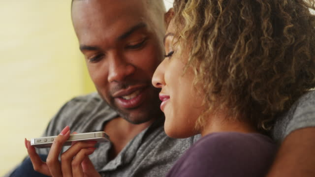 african couple talking on smartphone - public speaker stock videos & royalty-free footage