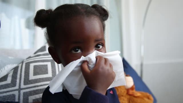 ms african ethnicity child blowing her nose, johannesburg, south africa - cold and flu stock videos & royalty-free footage
