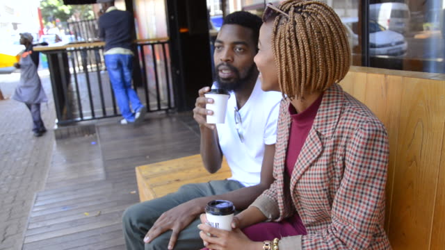 MS of African Ethnicity couple drinking coffee in Braamfontein / Johannesburg, Gauteng, South Africa
