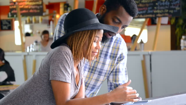 MS of African Ethnicity couple using digital tablet / Johannesburg, Gauteng, South Africa