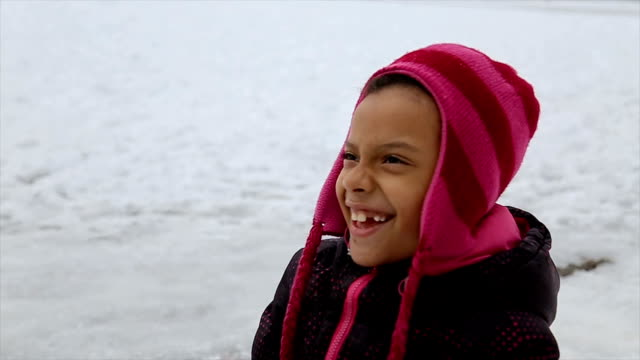 african ethnicity girl enjoying on the slide,winter fun on the snow - sliding stock videos & royalty-free footage