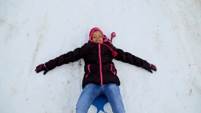 african ethnicity girl playing on the snow - ethnicity stock videos & royalty-free footage
