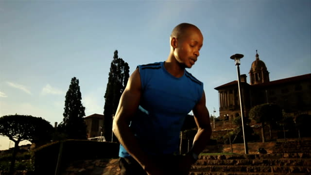ls african ethnicity male athlete stretching/ pretoria/ south africa - pretoria stock videos & royalty-free footage