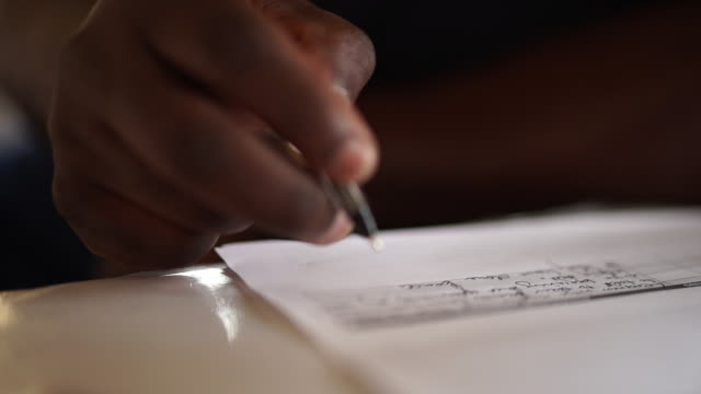 cu african ethnicity male hand writing on piece of paper/ kwazulu-natal/ south africa - writer stock videos and b-roll footage