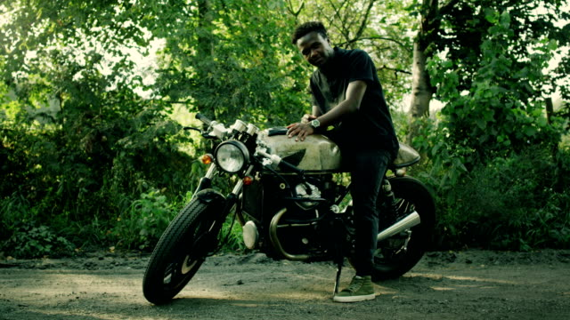 african ethnicity man and his machine. custom motorcycle - man and machine stock videos & royalty-free footage