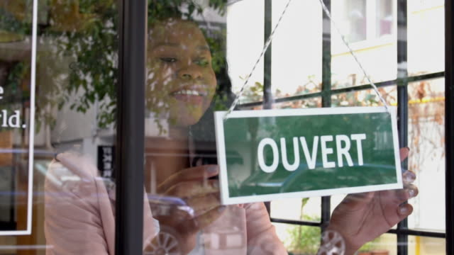 african ethnicity woman opening the store - french culture stock videos & royalty-free footage