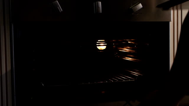 cu african ethnicity woman placing dough in oven/ cape town/ south africa - proofing baking technique stock videos and b-roll footage