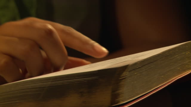 cu african ethnicity woman's hands reading through bible, cape town, south africa - bible stock videos & royalty-free footage