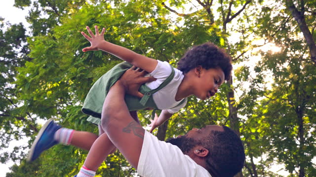 african family at park - outdoor pursuit stock videos & royalty-free footage