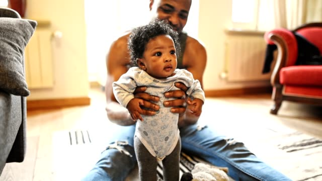 african family have fun in the sofa - young family stock videos & royalty-free footage