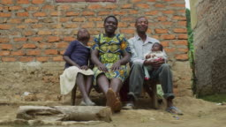 African family sitting on a bench