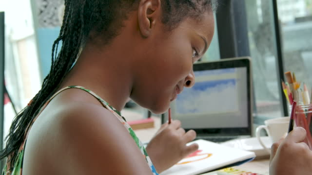 african girl student drawing picture at home. - artist stock videos & royalty-free footage