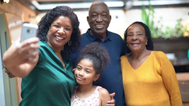 african hispanic family together at home taking selfies - multi-generation family - telecommunications equipment stock videos & royalty-free footage