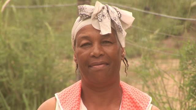 African lady looking at Camera 2- HD & PAL2